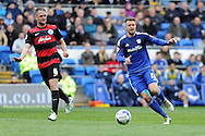 Cardiff City's Anthony Pilkington (r) and QPR's Clint Hill watch the ball. Skybet football league championship match, Cardiff city v Queens Park Rangers at the Cardiff city stadium in Cardiff, South Wales on Saturday 16th April 2016.<br /> pic by Carl Robertson, Andrew Orchard sports photography.