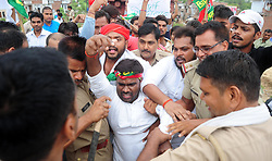 July 1, 2017 - Allahabd, Uttar Pradesh, India - Police detain Samajwadi party workers as they stop Ganga Gomati express during a protest against GST (Goods Service Tax) in Allahabad. (Credit Image: © Prabhat Kumar Verma/Pacific Press via ZUMA Wire)