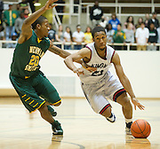 Jordan Adams (23) of Kimball drives past Dereon Hill (20) of Carrollton Newman Smith in the Class 4A area-round playoff game Friday, February 22, 2013 at the Alfred J. Loos Field House in Addison, Texas. (Cooper Neill/The Dallas Morning News)