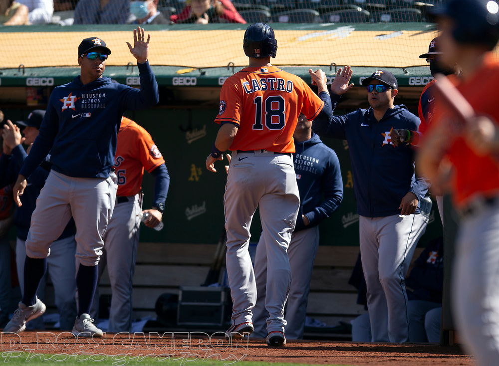 Sep 26, 2021; Oakland, California, USA; Houston Astros catcher Jason Castro (18) is congratulated by his teammates after scoring on single by Jose Siri against the Oakland Athletics in the fifth inning at RingCentral Coliseum. Mandatory Credit: D. Ross Cameron-USA TODAY Sports