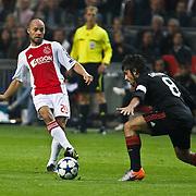 NLD/Amsterdam/20100928 - Champions Leaguewedstrijd Ajax - AC Milan, Demy de Zeeuw in duel metGennaro Gattuso