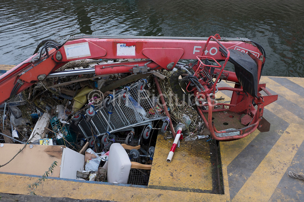 Shopping trolleys and other rubbish which has been lifted out of the Lea Navigational Canal in East London, UK. Trash and detritus thrown into the city canals is a constant problem that has to be cleared.