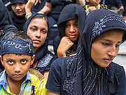 04 NOVEMBER 2014 - YANGON, MYANMAR: Burmese Shia Muslims at Mogul Mosque in Yangon on Ashura. Ashura, commemorates the death of Hussein ibn Ali, the grandson of the Prophet Muhammed, in the 7th century. Hussein ibn Ali is considered by Shia Muslims to be the third imam and the rightful successor of Muhammed. He was killed at the Battle of Karbala in 610 CE on the 10th day of Muharram, the first month of the Islamic calendar. According to Myanmar government statistics, only about 4% of the population is Muslim. Many Muslims have fled Myanmar in recent years because of violence directed against Burmese Muslims by Buddhist nationalists.     PHOTO BY JACK KURTZ