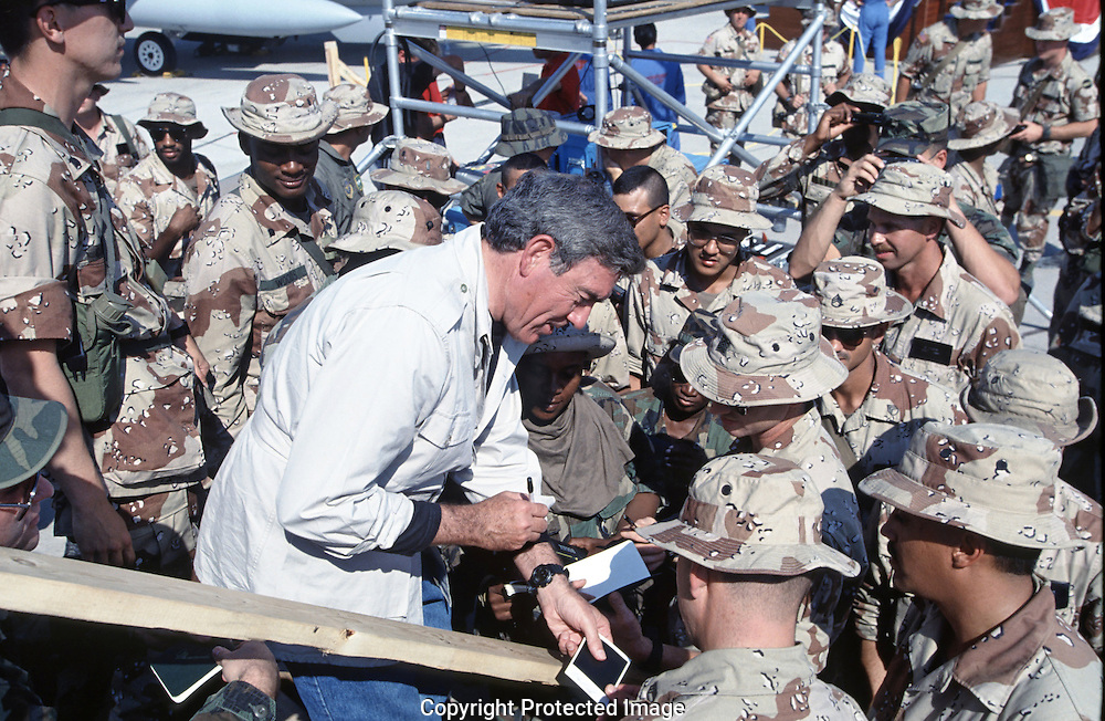 Dan Rather  visits troops near Dahahran, Saudi Arabia during the building up for the Gulf War in November 1990...Photograph by Dennis Brack bs b 17