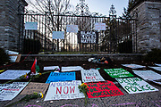 Protest signs are seen in front of Penn State's Allen Street Gates after a protest march to demand justice for Osaze Osagie.