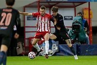 PIRAEUS, GREECE - NOVEMBER 25: John Stones of Manchester City and Kostas Fortounis of Olympiacos FC during the UEFA Champions League Group C stage match between Olympiacos FC and Manchester City at Karaiskakis Stadium on November 25, 2020 in Piraeus, Greece. (Photo by MB Media)