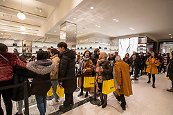 © Licensed to London News Pictures. 26/12/2019. . Queues form at Saint Laurent in Selfridges as Boxing Day bargain hunters brave the cold and the rain in Oxford Street for a chance to get large discounts on designer items at Selfridges this morning . Alex Lentati/LNP