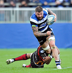 Bath second row Ryan Caldwell is tackled in possession - Photo mandatory by-line: Patrick Khachfe/JMP - Tel: Mobile: 07966 386802 19/10/2013 - SPORT - RUGBY UNION - Recreation Ground - Bath - Bath V Newport Gwent Dragons - Amlin Challenge Cup