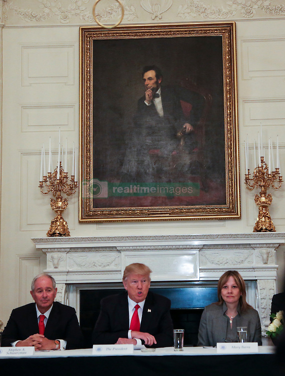 Washington, DC - February 3, 2017; U.S. President Donald speaks before a strategy and policy forum, flanked by CEO of the Blackstone Group Stephen Allen Schwarzman (L) and Chief Executive Officer and Chairperson of the General Motors Mary Barra (R) in the State Dining Room of the White House.