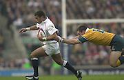 Twickenham, England, Autumn International. RFU Twickenham Stadium<br /> 16/11/2002<br /> International Rugby - England vs Australia.<br /> Jason Robinson evades Matthew Burkes challenge         [Mandatory Credit:Peter SPURRIER/Intersport Images]