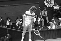 John McEnroe (USA) throws his racket in anger during his stormy semi-final match against Australian Rod Frawley.