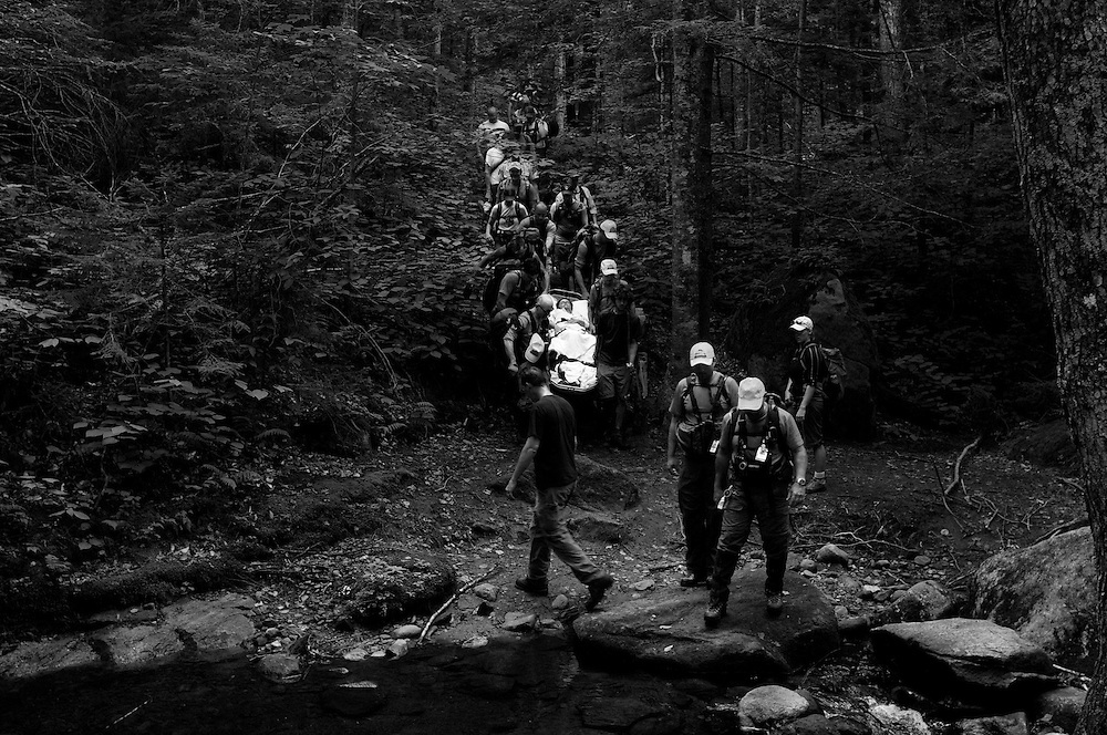 While descending from the summit of Mount Cube with her family Thursday, July 5, 2012, Christina Brownell, 47, slipped and fell injuring her back on a rock. A team of more than 20 from Upper Valley Ambulance, NH Fish and Game, Upper Valley Wilderness Response Team and a handful of Appalachian Trail hikers worked to carry her down two miles of trail to a waiting ambulance.<br /> Valley News - James M. Patterson<br /> jpatterson@vnews.com<br /> photo@vnews.com