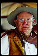 Portrait of an old time cowboy with glasses at Cowboy Hall of Fame chuckwagon chili cookoff.