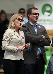 Peter and Autumn Phillips watch daughters Savannah and Isla on a climbing wall during the Royal Windsor Horse Show, which is held in the grounds of Windsor Castle in Berkshire.