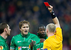 Red card of referee Szymon Marciniak of Poland during football match between NK Maribor and Wigan Athletic FC (ENG) in Round 6 of Group D of UEFA Europa League 2014, on December 12, 2013 in Stadion Ljudski vrt, Maribor, Slovenia. Photo by Vid Ponikvar / Sportida