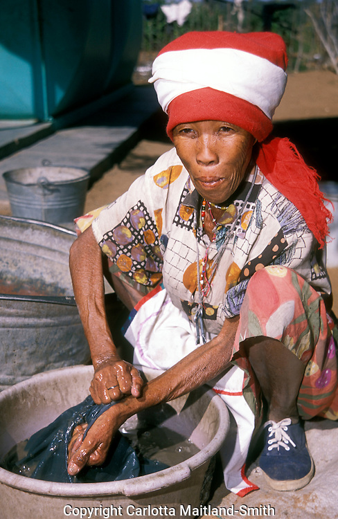 San woman small town of Drimiopsis in Central eastern namibia  San bushmen have an oriental look and heart-shaped faces. .Namibia's earliest inhabitants and one of the most heavily studied peoples in the history of anthropology. .They enjoy many interesting traditional games and dances. One such game involves dancing whilst tossing the melon from one to another, to the singing and clapping of the rest of the village...