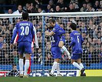 Photo: Lee Earle.<br /> Chelsea v Birmingham City. The Barclays Premiership.<br /> 31/12/2005.<br /> Chelsea's Eidur Gudjohnsen (CL) congratulates Arjen Robben (CR) on his goal.