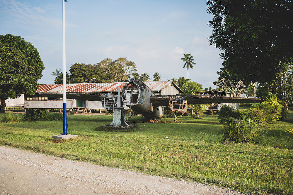An American B-25 Mitchell bomber, which saw service during World War II, has stood since 1974 in front of the high school in Aitape, Papua New Guinea. In October 1944 it was declared war weary and soon abandoned in a bone yard at Tadji airfield, on the outskirts of Aitape. It's tail was missing when it was brought to the high school three decades later, so the tail from another B-25 wreck was attached to it.<br /> <br /> (July 19, 2017)