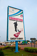 Rwanda February 2014. Anti corruption billboard encouraging people to 'sweep it away', saying, in English, corruption undermines your integrity.