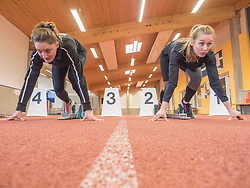 Two women runners on tartan track in starting position, Offenburg, Baden-Wuerttemberg, Germany