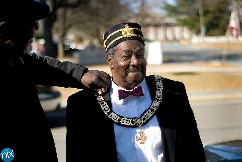 Robert Ware, at left, helps adjust Bobby Bolber's medallion prior to representing the King Uzziah Masonic Lodge in the Martin Luther King Day parade in Concord Monday afternoon.