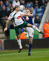 Photo: Steve Bond/Richard Lane Photography. Leicester City v Plymouth Albion. Coca Cola Championship. 21/11/2009. Jim Patterson (L) gets to the ball in front of Robbie Neilson (R)