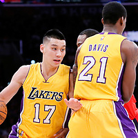 27 January 2015: Los Angeles Lakers guard Jeremy Lin (17) drives past a screen set by Los Angeles Lakers forward Ed Davis (21) during the Washington Wizards 98-92 victory over the Los Angeles Lakers, at the Staples Center, Los Angeles, California, USA.