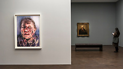 "© Licensed to London News Pictures. 11/04/2019. LONDON, UK. A visitor views ""Self-Portrait with Two Circles"", 1665, (R) by Rembrandt van Rijn, the highlight of the exhibition.  ""Untitled"", 2019, (L) by Jenny Saville, is a new work, seen for the first time, created in response to Rembrandt's self-portrait.  Preview of ""Visions of the Self:  Rembrandt and Now"", an exhibition at Gagosian Grosvenor Hill, in partnership with English Heritage.  The show features self-portraits by Pablo Picasso, Frances Bacon, Lucian Freud and Jean-Michel Basquiat alongside contemporary artists including George Baselitz, and Damian Hirst.  Photo credit: Stephen Chung/LNP"