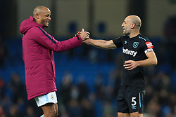 3rd December 2017 - Premier League - Manchester City v West Ham United - Vincent Kompany of Man City (L) shakes hands with former teammate Pablo Zabaleta of West Ham after the match - Photo: Simon Stacpoole / Offside.
