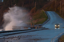 © Licensed to London News Pictures. 13/01/2020. Amroth, Carmarthenshire, Wales, UK. Motorists negotiate the coast road between Amroth and Pendine as Storm Brendan hits the South West coastline of  Wales, UK. Photo credit: Graham M. Lawrence/LNP