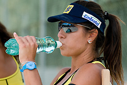 Maria Antonelli of Brasil drinking water on a bench at A1 Beach Volleyball Grand Slam tournament of Swatch FIVB World Tour 2010, on July 28, 2010 in Klagenfurt, Austria. (Photo by Matic Klansek Velej / Sportida)