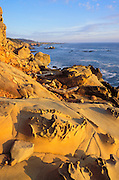 Evening light on eroded rock formations along the Sonoma Coast, Salt Point State Park, California