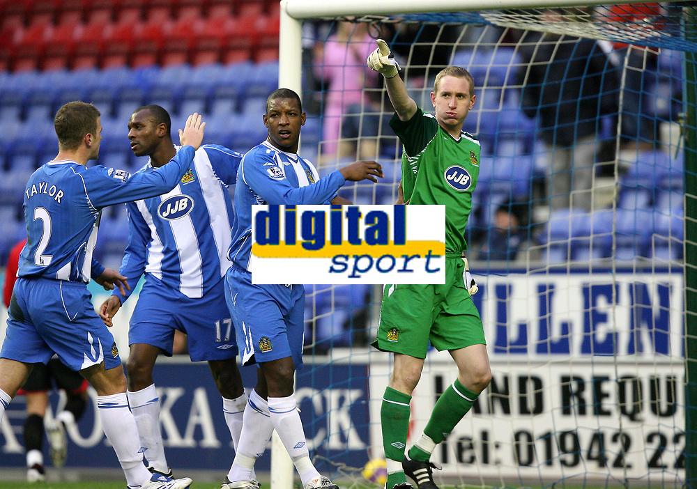 Photo: Paul Greenwood/Sportsbeat Images.<br />Wigan Athletic v Blackburn Rovers. The FA Barclays Premiership. 15/12/2007.<br />Wigan's keeper Chris Kirkland (R)  gestures towards the bench after he saves Benni McCarthy's penalty