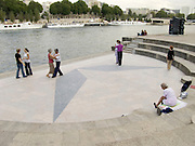people learning the tango in Paris on the banks of the Seine
