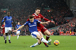 Liverpool's Andrew Robertson (right) and Everton's Jonjoe Kenny battle for the ball during the Premier League match at Anfield, Liverpool.