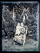 girl posing with smiling toddler France ca 1920s