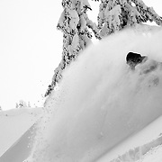 Tyler Hatcher skis out of the darkness during a brief clearing in the backcountry near Mount Baker Ski Area.