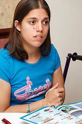 Young white student, who has Cerebral Palsy and uses a walking frame, in study group.
