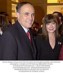 Former Mayor of New York RUDY GIULIANI and his girlfriend MISS JUDY NATHAN at a party in London on 14th February 2002.OXM 118 2olo