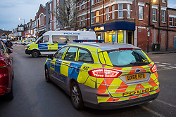 © Licensed to London News Pictures. 29/04/2021. London, UK. Police vehicles form a cordon on High Road in Willesden following the fatal stabbing of a 40-year-old man. Police were called by London Ambulance Service at 17:11 BST to a report of a man suffering from stab wounds, despite the efforts of the emergency services the man was pronounced dead at the scene. Photo credit: Peter Manning/LNP