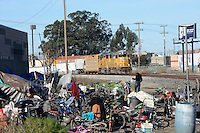 A freight train rounds the bend by this lonely spot, home to perhaps ten homeless people in Salinas.
