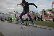 Skateboarder at Picadilly Gardens, Manchester, UK.