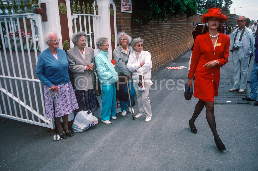 Five elderly women on-lookers are lined against a wall outside the famous Ascot race course on Ladies Day, the annual event on the English sporting and social calendar in June, on 18th June 1992, in Ascot, England.