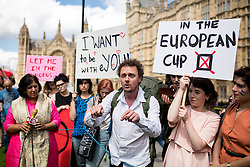 © Licensed to London News Pictures. 24/06/2016. London, UK. A pro-EU demonstration assembles as Members of Parliament and political commentators meet with media on College Green to discuss Britain's decision to leave the European Union, and Prime Minister David Cameron's resignation. Photo credit : Tom Nicholson/LNP