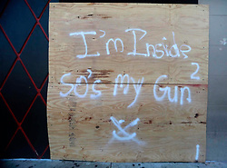 September 11, 2017 - Lake Worth, Florida, U.S. - A piece of plywood on Propaganda in Lake Worth lets people know ''I'm inside, so's my gun'' Monday. (Credit Image: © Bruce R. Bennett/The Palm Beach Post via ZUMA Wire)
