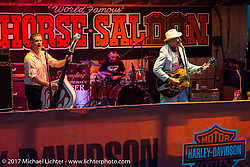 """Kenny Duda on guitar with Rob """"Bobcat"""" Bundy slapping the double bass as the Razorbacks Rock-A-Billy band play the Iron Horse Saloon during Daytona Bike Week. Ormond Beach, FL, USA. Thursday March 9, 2017. Photography ©2017 Michael Lichter."""