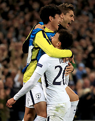 Tottenham Hotspur's Dele Alli (bottom) celebrates scoring his side's second goal of the game with team-mates during the UEFA Champions League, Group H match at Wembley Stadium, London.