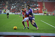 Shay Facey of Rotherham United and Morgan Fox of Charlton Athletic fight for the ball  during the Sky Bet Championship match between Rotherham United and Charlton Athletic at the New York Stadium, Rotherham, England on 30 January 2016. Photo by Ian Lyall.