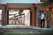 Young men in a ghetto housing estate in town of Kourou in French Guiana, home of the European Space Agency's Spaceport.