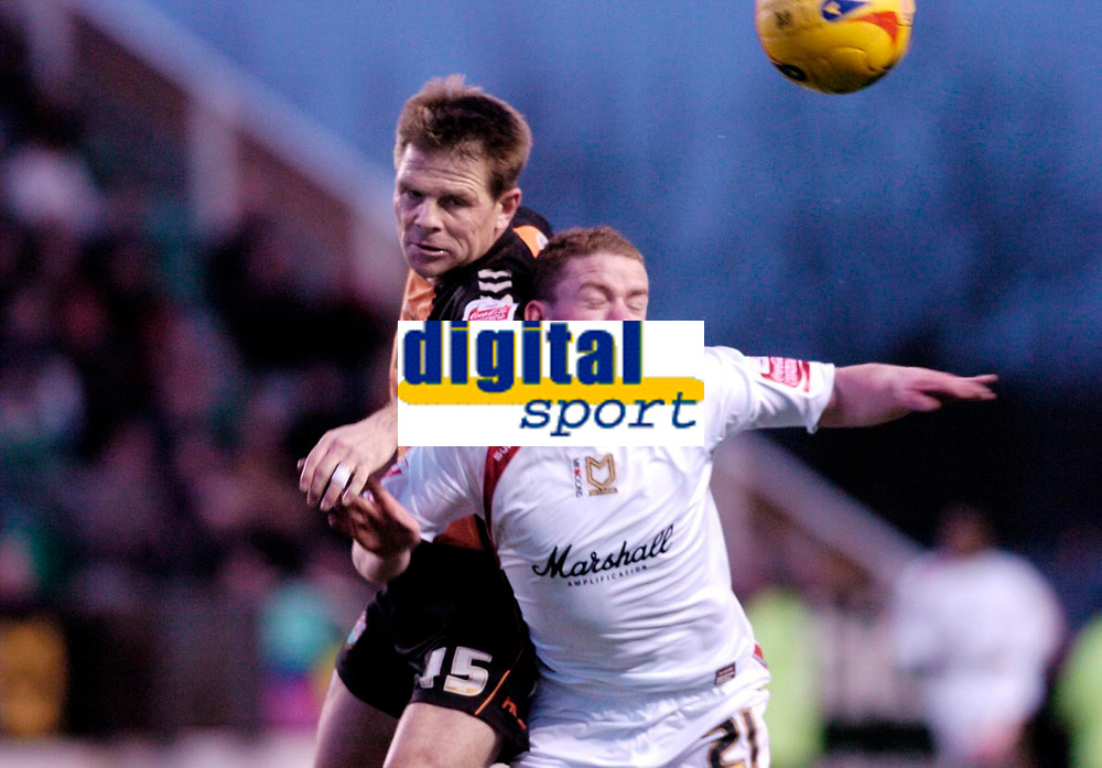 Photo: Leigh Quinnell.<br /> Milton Keynes Dons v Barnet. Coca Cola League 2. 20/01/2007. Barnets Andy Hessenthaler battles in the air with MK Dons Jonathan Hayes.